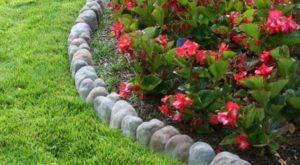 aiuole fiorite giardino con cordoli in pietra